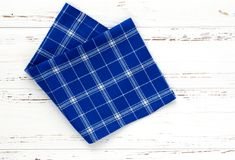 Blue kitchen cloth on white vintage wooden table. copy space.  Stock Photos