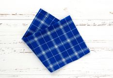 Blue kitchen cloth on white vintage wooden table. copy space.  Royalty Free Stock Images