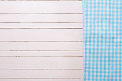 Blue kitchen towel  on white wooden background. Stock Photo