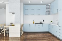 Blue kitchen, white furniture. White kitchen interior with a dark wooden floor and blue countertops. A white table with chairs. 3d rendering mock up Stock Image