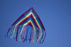 Blue kite in blue sky. Blue kite flying in middle of blue sky Stock Photo