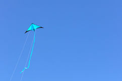 Blue kite flying Stock Photography