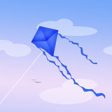 Blue kite in the sky Royalty Free Stock Photos
