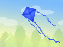 Blue kite in the sky Royalty Free Stock Images