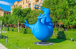The blue kiwi. YEREVAN, ARMENIA - MAY 29, 2016: The blue kiwi, holding the metal ball in beak in Cafesjian sculpture garden, on May 29 in Yerevan royalty free stock image