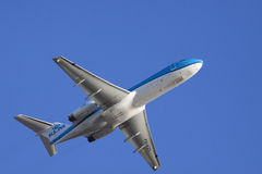 Blue klm boeing on a cloudless sky Stock Photo