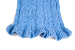 Blue knit cashmere scarf. Cable knit pattern with a ruffled edge Stock Photos