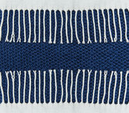 Blue knited background with white fringe frame.Hand Made. Royalty Free Stock Photos