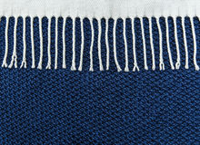 Blue knited background with white fringe.Hand Made.Top view Royalty Free Stock Images