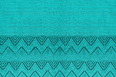 Blue knitted background. With openwork patterned border closeup Stock Image