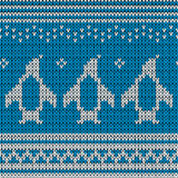 Blue knitted Background with penguins. Stock Photo