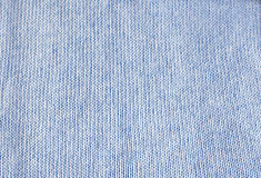 Blue knitted background, texture, pattern. Blue knitted background, knitted texture, pattern. Close-up. Horizontal. Copy space Stock Photography