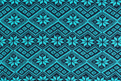 Blue knitted background. With a winter pattern Stock Images