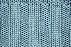 Blue knitted fabric. Textured background Royalty Free Stock Photos