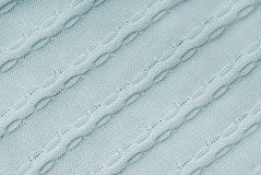 Blue knitted fabric. Creative backgrounds, close-up of sweater Stock Photos