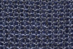 Knitted yarn. Blue knitted fabric with sequins Stock Images