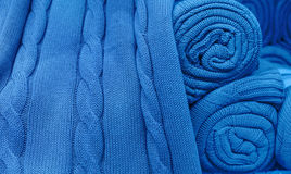 Blue knitted fabric twisted into a roll Stock Photo