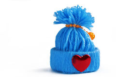 Blue knitted hat with a heart. On a white background Stock Photos