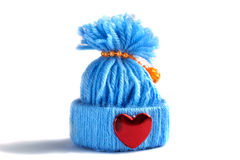Blue knitted hat with a heart. On a white background Royalty Free Stock Photography