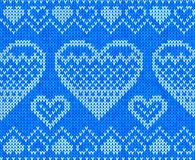 Blue knitted hearts vector seamless pattern Stock Photos