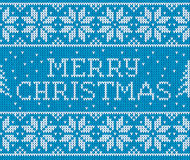 Blue knitted seamless pattern with sign Merry Stock Photography