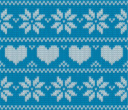 Blue Knitted stars and hearts sweater in Norwegian style. Stock Photo