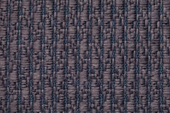 Blue knitted woolen background with a pattern of soft, fleecy cloth. Texture of textile closeup. Stock Image