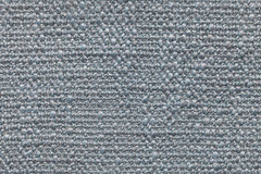Blue knitted woolen background with a pattern of soft, fleecy cloth. Texture of textile closeup. Royalty Free Stock Photos