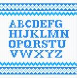 Blue knitting alphabet on white background Royalty Free Stock Photo
