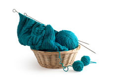 Blue knitting and clews in the basket Royalty Free Stock Photography
