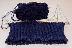 Blue knitting wool and knitting needles. royalty free stock photography