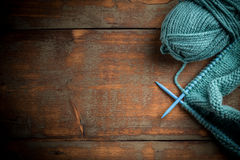 Blue knitting wool. And knitting needles Royalty Free Stock Images