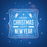 Blue Label with Christmas Greeting on a Dark Background Royalty Free Stock Photo