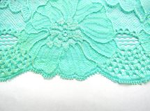 Blue lace fabric  on white background from above Stock Photography
