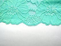 Blue lace fabric  on white background from above Stock Photo