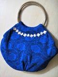 Blue lace handbag with rhinestones, handmade stock photography