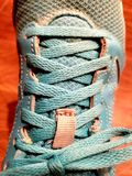 Blue laces on tennis shoes. Excersise, workout, tie stock photos