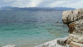 Blue lagoon beach coast, Kassiopi village, Corfu Island, Greece. Rocky coast of Ionian Sea with clear turquoise water.  stock video footage