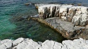 Blue lagoon beach coast, Kassiopi village, Corfu Island, Greece. Rocky coast of Ionian Sea with clear turquoise water.  stock footage