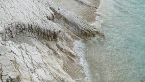 Blue lagoon beach coast, Kassiopi village, Corfu Island, Greece. Rocky coast of Ionian Sea with clear turquoise water.  stock video