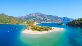 Blue lagoon and beach in Oludeniz, Turkey. Aerial view of blue lagoon and pebble beach in Oludeniz, Fethiye district, Turquoise Coast of southwestern Turkey stock photography