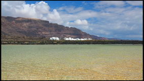 Blue Lagoon. Breezes in shallow waters. Fishing village Orzola, Lanzarote, Canary Islands. Crystalline lagoon surrounded by white stock video
