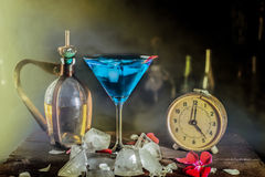 Blue lagoon cocktail on the table. Cocktail table setting blue lagoon royalty free stock photo