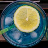 Blue lagoon coctail with lemon. Coctail drink Blue Lagoon with lemon slice and ice Stock Photo