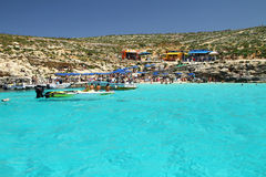 Blue Lagoon - Comino - Malta. Exotic waters in the Blue Lagoon on the tiny island of Comino with Gozo in the distance in the Mediterranean islands of Malta Royalty Free Stock Photos