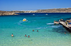 Blue Lagoon, Comino - Malta. Tourists enjoying the crystal clear waters of the Blue Lagoon, Comino Island, Malta Stock Images