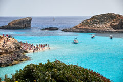 BLUE LAGOON, COMINO, MALTA - APRIL 13, 2016. People enjoy blue lagoon  with crystal clear blue water. Stock Images