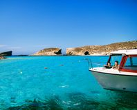 Blue lagoon - Comino, Malta. Boats at blue lagoon - Comino, Malta Royalty Free Stock Image