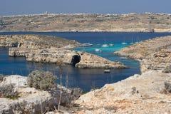 Blue Lagoon, Comino, Malta. The famous blue lagoon in Comino, Malta. Gozo in the background Stock Image