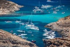 Blue lagoon at Comino - Malta. COMINO, MALTA - JULY 16: Ship at  Blue lagoon at island Comino - Malta on July 16, 2015 in Comino Stock Image